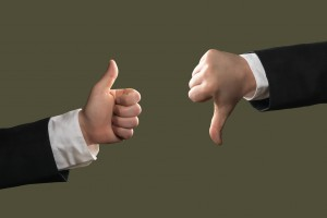 Hands of businessmen shows Thumbs Up and Down